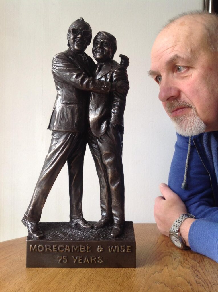 Sculptor Graham Ibbeson with the maquette of Morecambe and Wise