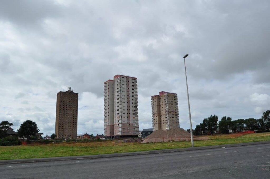 Three tower blocks at Queens Park flats, just before demolition on 31.7.16. Photo: Juliette Gregson