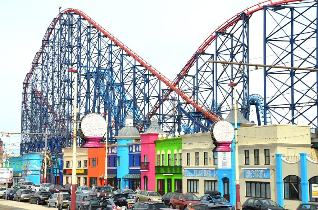 Shops that line the edge of the promenade, against the Pleasure Beach