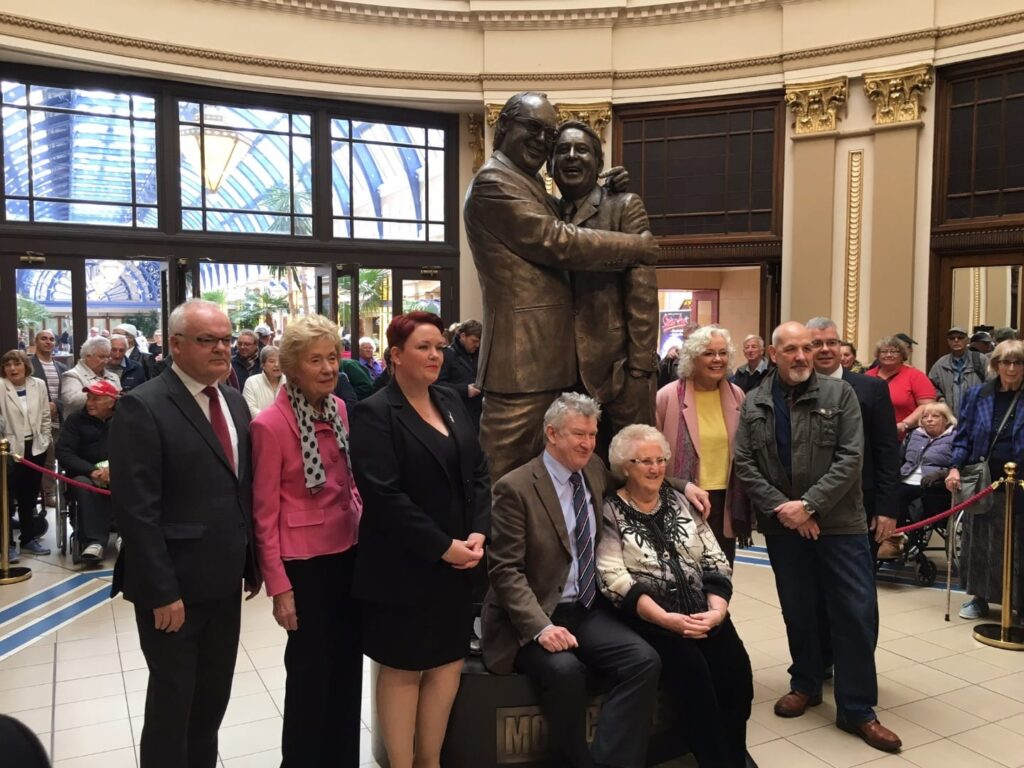 Family of Morecambe and Wise with local dignitaries and sculptor Graham Ibbeson. Photo: Visit Fylde Coast