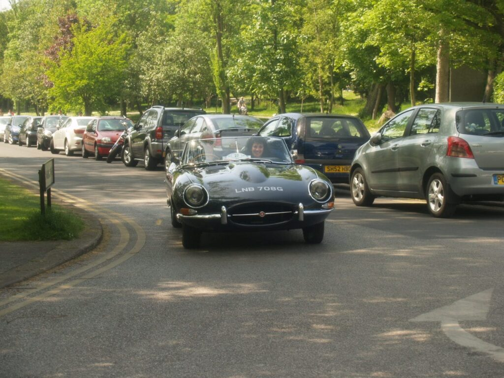 John Barnett, Chairman and Founder of Radio Wave, in his E Type Jaguar
