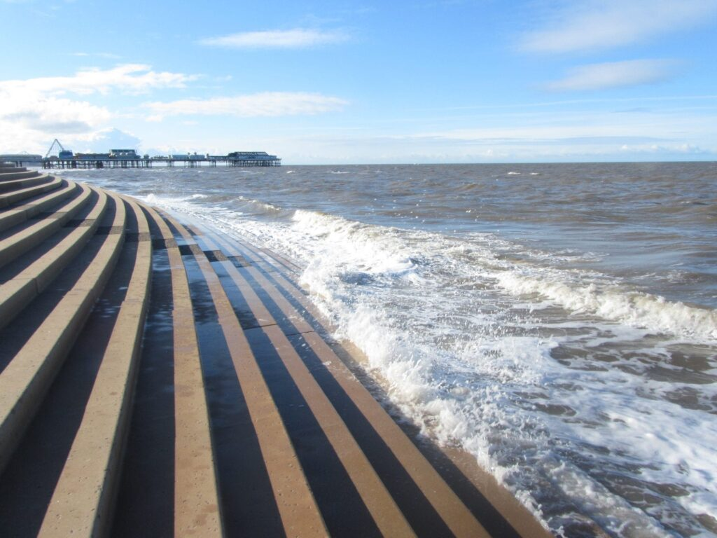 Waves trickling up the steps at Blackpool promenade